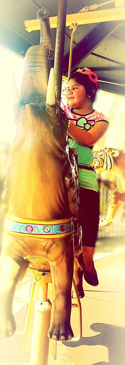 real people, childhood, leisure activity, lifestyles, fun, indoors, one person, happiness, day, carousel
