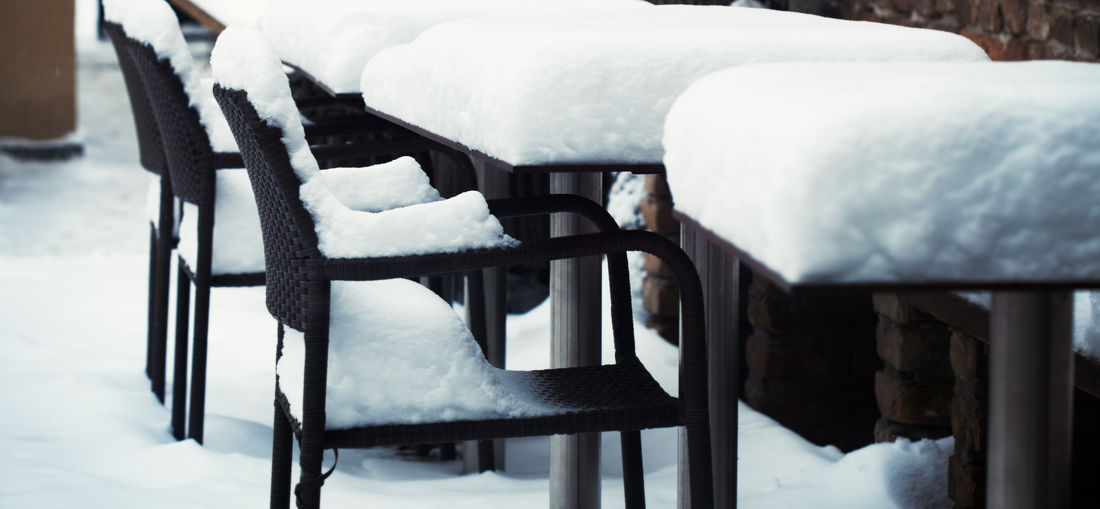 Frozen Chairs And Tables Arranging In Cafe