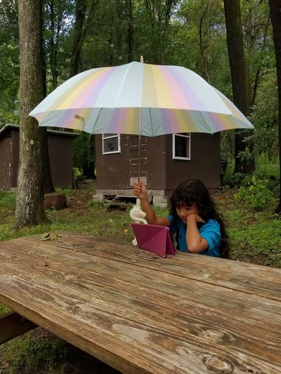 young girl watching YouTube in the rain Japanese  Irish Italian Mixed Girl Unicorn Tablet Picnic Yard Church Tree Childhood Girls Protection Umbrella Beach Umbrella Rain Children The Still Life Photographer - 2018 EyeEm Awards 10