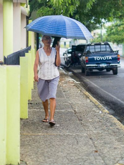 Lluvia #eabreutravels #eabreudr #thedominicanrepublic #dominicanrepublic #republicadominicana #travelphotography #travel #canon_official #canon_photos #canon #canonphotography #canonphoto #canon5dmarkiii dominicanxs Full Length Casual Clothing Rear View Lifestyles Childhood Leisure Activity Transportation Mode Of Transport Street Incidental People Land Vehicle Person Front View Holding Day The Way Forward Outdoors Casual
