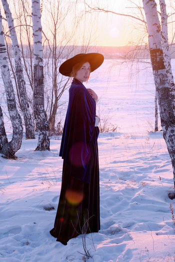 Girl at sunset. Women One Person Winter Snow Hat Tree Warm Clothing Sunset Cold Temperature Land Nature Field Lifestyles