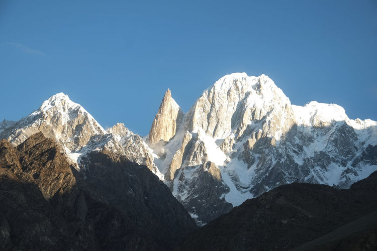 Ladyfinger peak and Hunza peak in Karakoram mountain range. Hunza valley, Gilgit Baltistan, Pakistan. Ladyfinger Peak Hunza Peak Clear Blue Sky Trekking Hiking Climbing Summit Pakistan Hunza Valley Gilgit Baltistan Travel Destinations Landscape Mountains Mountain Range Snow Capped Mountains Karakoram Wild Wilderness Mountaineering Eco Tourism Climate Ecology Environment Countryside Famous Landmarks Beautiful Scenery Peaceful Peace And Quiet Serenity Beauty In Nature Scenics - Nature Tranquil Scene Cold Temperature Tranquility Height High Altitude No People Outdoors Day