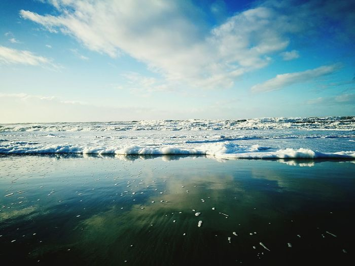Water Reflection Sea Nature Outdoors Sky Beauty In Nature Cold Temperature Tranquil Scene Tranquility Day No People Scenics Beach Horizon Over Water Traveling Home For The Holidays