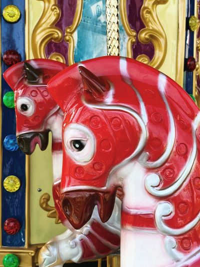 Carousel horses 🐴... Carnival Amusement Park Background Creativity Decoration Painted Playing Colorful Horse Childhood Design Fun Playground Environment Plastic Red Carousel Horses Carousel Art And Craft Representation No People Creativity Indoors  Red Close-up Multi Colored Built Structure Craft Sculpture Festival