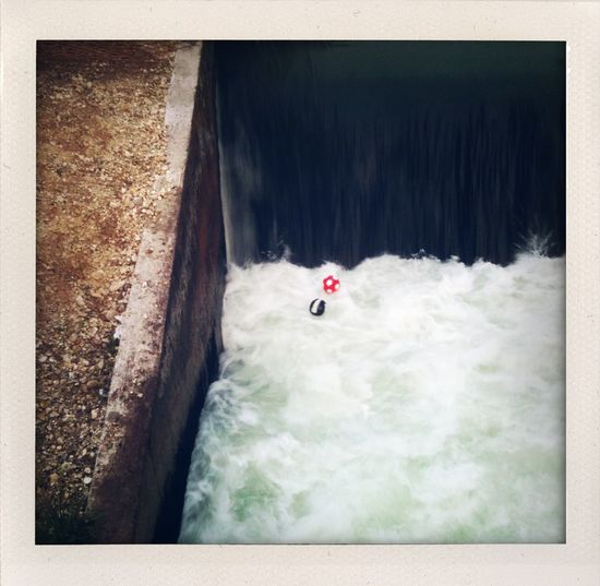 Two rubber balls caught in the white water of the #Eisbach (?) close to Englischer Garten in #Munich.