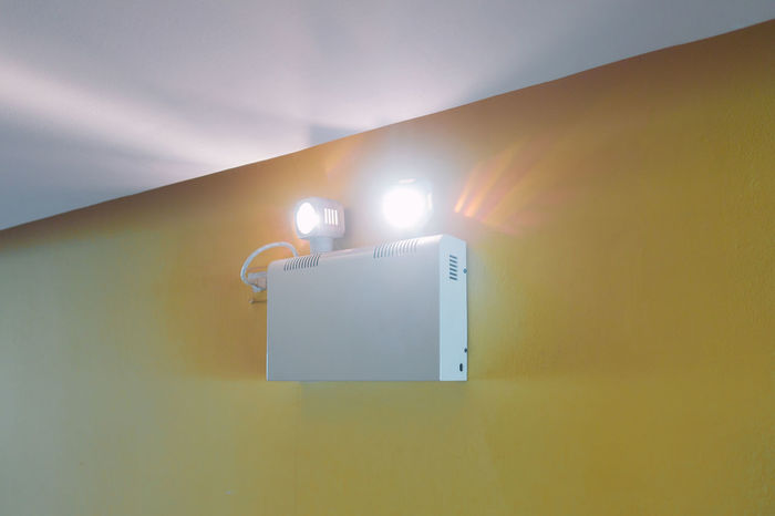 Emergency light working when power outage by battery Architecture Building Exterior Built Structure Close-up Day Emergency Light Illuminated Indoors  Low Angle View No People Sky Yellow