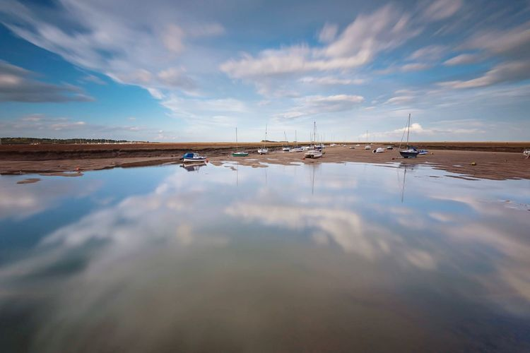 Wells Harbour, Norfolk Blue Sky Reflections Nature Photography Landscape_photography Sea View Wells-next-the-Sea Harbour Seaside Norfolk North Norfolk Seascape Nikon Travel Destinations Cloudscape Cloudporn Water Cloud - Sky Reflection Sky Sea Beauty In Nature Scenics - Nature No People Nautical Vessel Beach Low Tide