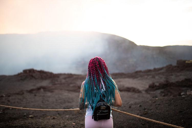 Rear view of woman walking on mountain