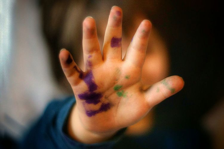 Close-up of painted child hand
