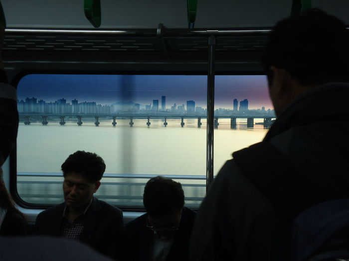 Architecture Built Structure City Connection Day Ferry Indoors  Leisure Activity Lifestyles Men Mode Of Transport Passenger Public Transportation Rear View Sea Sitting Sky Sunset Technology Train - Vehicle Transportation Travel Urban Water