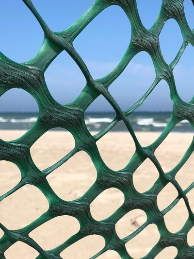 Full frame shot of metal fence at beach