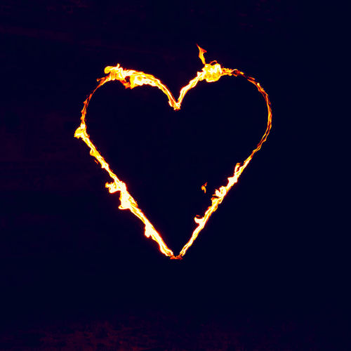 Close-up of heart shape decoration against sky at night