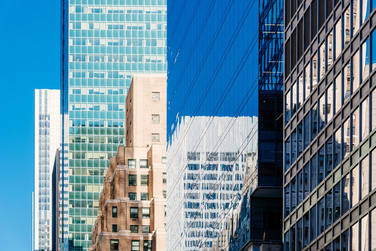 Skyscrapers and office buildings in NYC City Cityscape New York New York City New York Skyline  USA America Architecture Blue Building Building Exterior Built Structure Business City Corporate Business Day Downtown District Financial District  Glass - Material Low Angle View Modern No People Office Office Building Exterior Outdoors Reflection Skyscraper Window