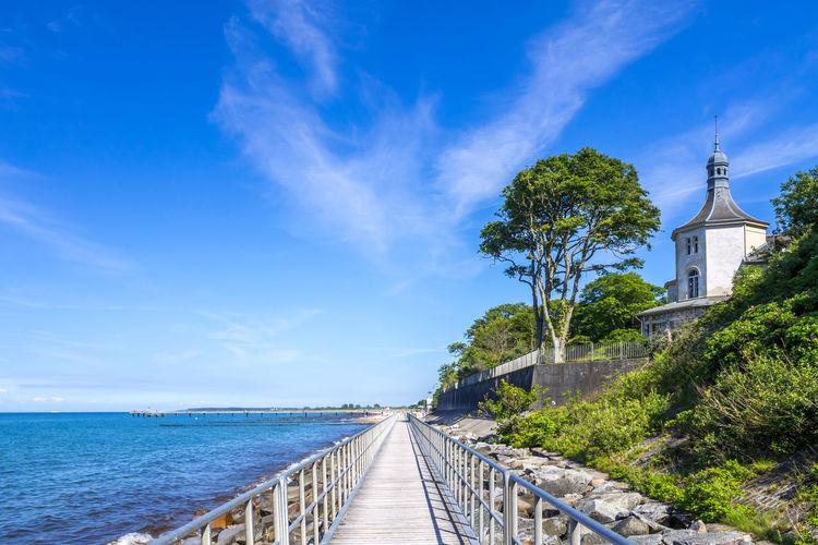Empty walkway by sea