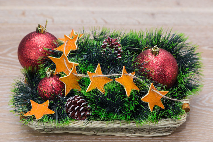 Close-Up Of Christmas Decorations In Basket On Table