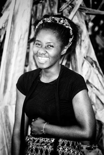 Smiling add years to your life. Keep smiling, beautiful African. Smiling Portrait Looking At Camera Waist Up Girls Happiness One Girl Only Real People Outdoors Beautiful Woman First Eyeem Photo Lifestyles EyeEmNewHere Life Journeys Black & White Beautiful Blackandwhite Photography Discover The World Life Journey EyeEm Best Shots - Nature