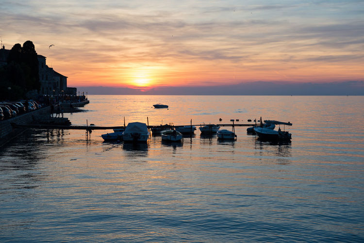 View of beautiful sunset above the Adriatic sea, Porec, Croatia Architecture Beauty In Nature Boat Cloud - Sky Day Horizon Over Water Jet Boat Mode Of Transport Moored Nature Nautical Vessel No People Outdoors Reflection Rippled Scenics Sea Sky Sunset Tranquil Scene Tranquility Transportation Water Waterfront