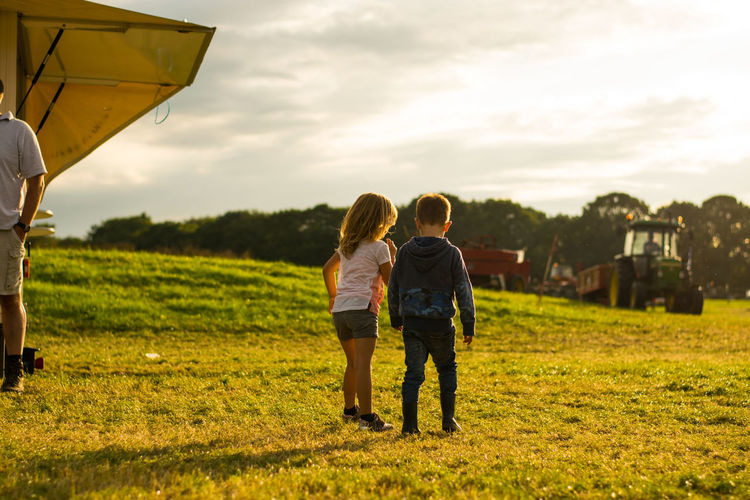 Friendship. ♡   Bonding Casual Clothing Day Field Friendship Full Length Grass Kid Leisure Activity Lifestyles Love Men Nature Outdoors People Real People Rear View Sky Sunset Togetherness Two People Women