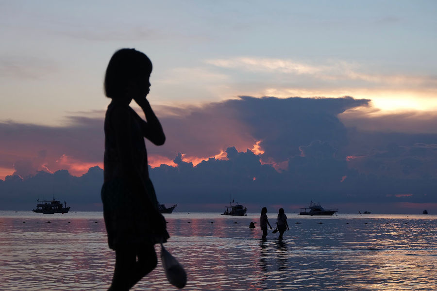 Beauty In Nature Boys Childhood Cloud - Sky Enjoyment Fun Holding Leisure Activity Lifestyles Nature Person Scenics Sea Side View Sky Standing Sunset Thailand Three Quarter Length Tourism Tourist Tranquil Scene Tranquility Vacations Water