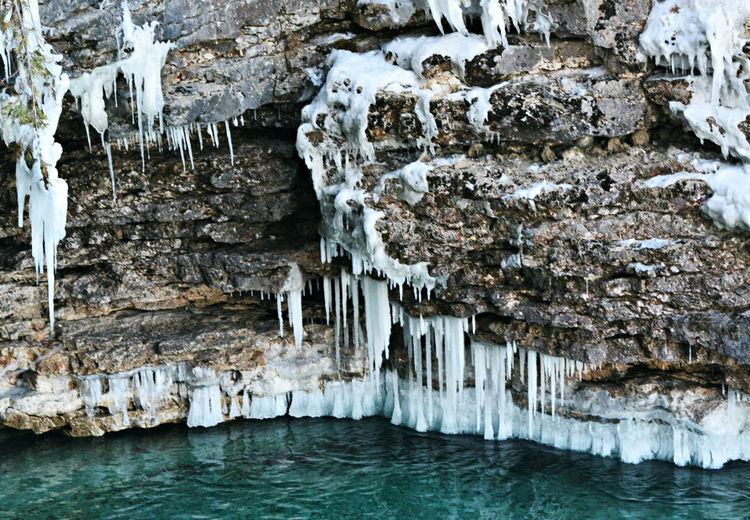 Beauty In Nature Cave Cliffside Day Frozen Ice Icesickles Nature No People Outdoors Rock - Object Rock Formation Stalactite  Water