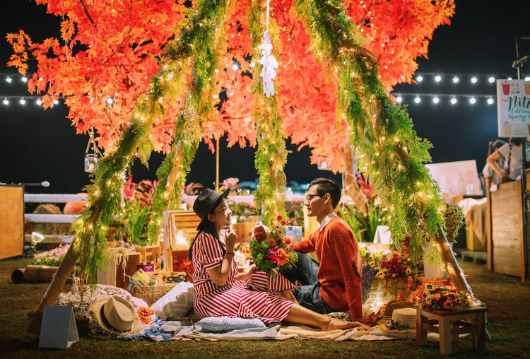 One is loved because one is loved. no reason is needed for loving.💕 Illuminated Real People Plant Tree Men Adult Sitting Women Group Of People Table Lifestyles Nature Food And Drink Night Leisure Activity Autumn People Outdoors Light Celebration Nightphotography Bokeh Love Love ♥ Light And Shadow