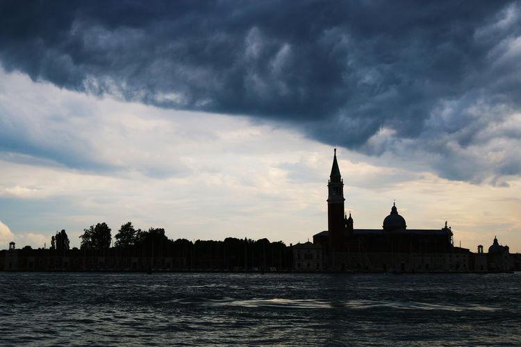 Grand canal against silhouette church of san giorgio maggiore