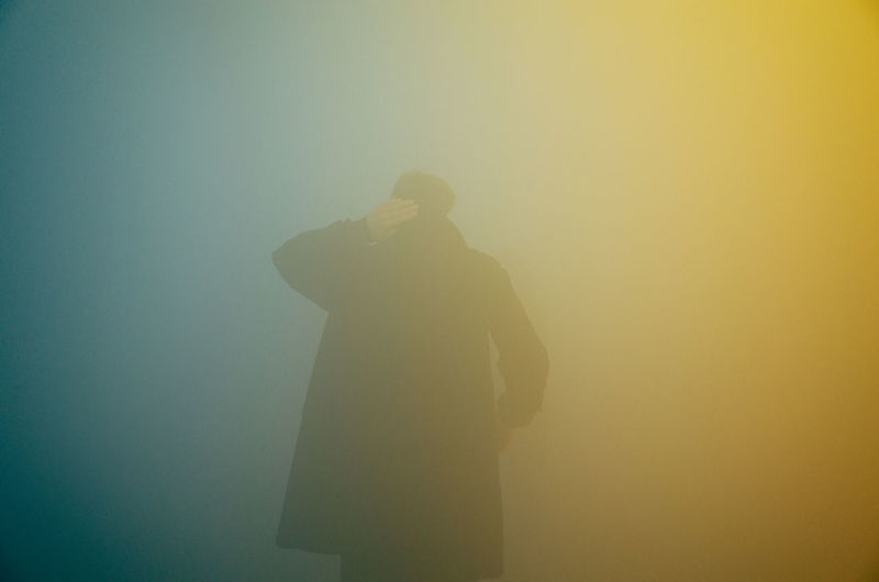 Rear view of man in foggy weather