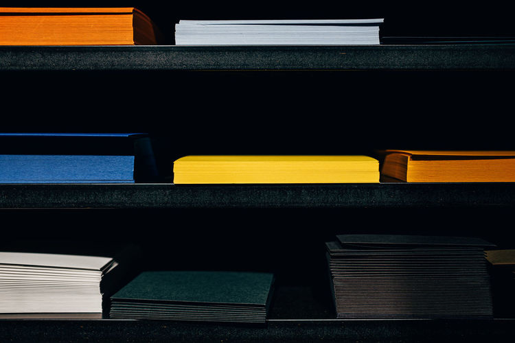 View of multi colored files on shelf