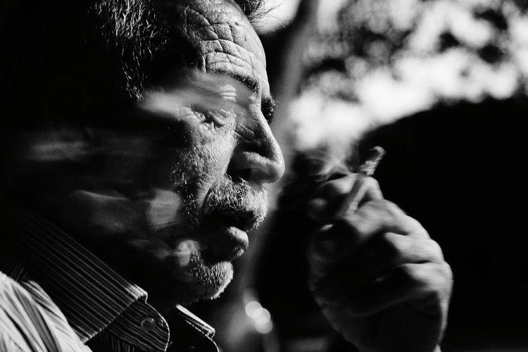 Close-Up Of Man Smoking Cigarette Outdoors