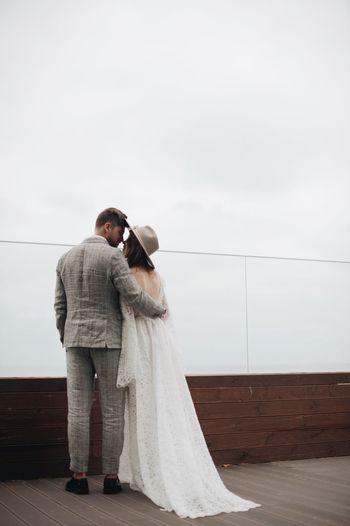 Bride and bridegroom on boardwalk