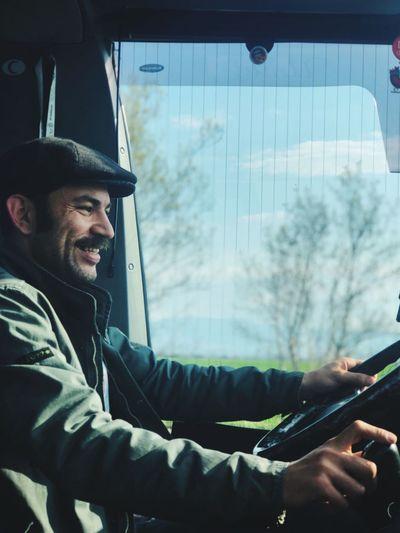 Smiling man driving car