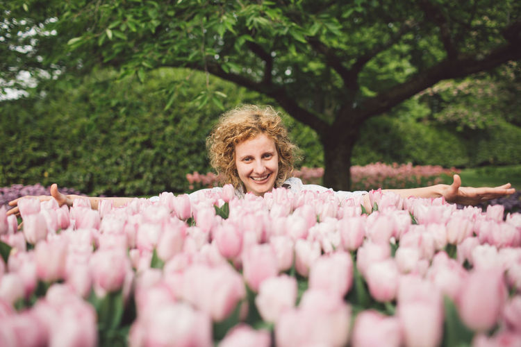Netherlands Beautiful Woman Beauty In Nature Curly Hair Day Embracing Flower Flowering Plant Freshness Front View Girl Growth Hairstyle Headshot Looking At Camera Nature One Person Outdoors Pink Color Plant Portrait Real People Smiling Spring Tree Women 50 Ways Of Seeing: Gratitude