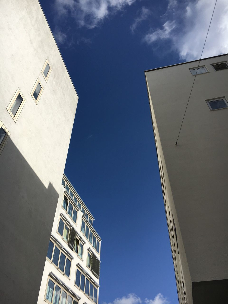 architecture, low angle view, building exterior, built structure, sky, day, cloud - sky, outdoors, no people, sunlight, nature, city