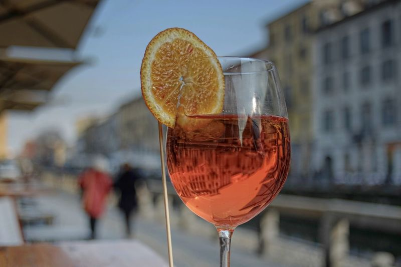 Close-up of alcoholic drink in city