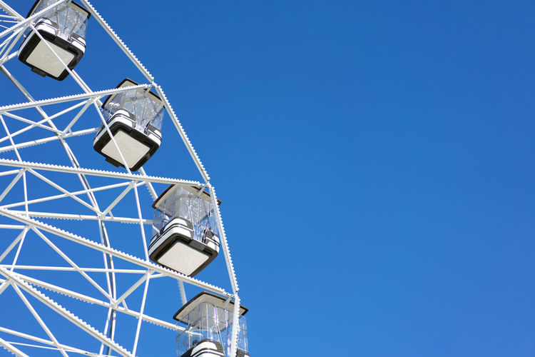 Amusement Park Amusement Park Ride Architecture Blue Building Exterior Built Structure Clear Sky Copy Space Day Ferris Wheel Lighting Equipment Low Angle View Metal Nature No People Outdoors Silver Colored Sky Street Light Sunlight Tower