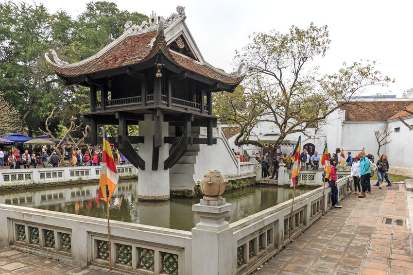 Hanoi, Vietnam - February 23, 2016: Tourists visiting the One Pillar Pagoda of Hanoi in Vietnam Architecture Built Structure Culture Cultures Day Hanoi Hanoi Vietnam  Ho Chi Minh Mausoleum Leisure Activity Lifestyles Old Town One Pillar Pagoda Outdoors Place Of Worship Religion Sky Spirituality Temple Temple - Building Tourism Tourists Tradition Travel Destinations Tree Vietnam