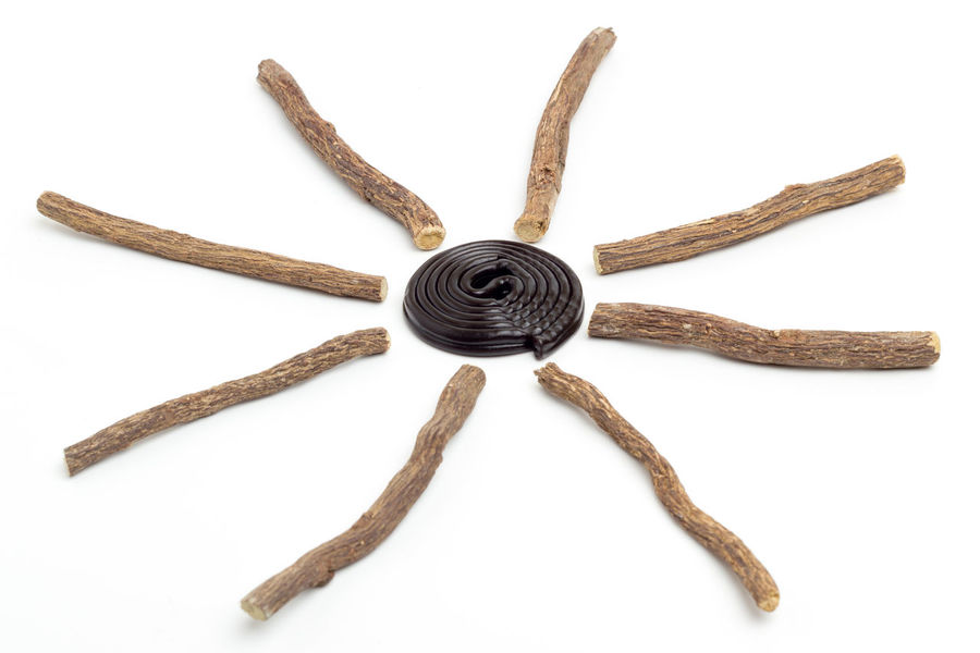Liqorice roots and black wheel on white background Aromatic Ayurveda Bio Biological Black Candy Clock Cold Diet Food Health Healthy Herb Herbal Ingredient Isolated Licorice Liquorice Medicinal Medicine Natural Nature Organic Plant Roots
