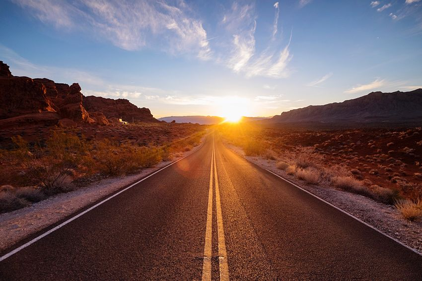 Early morning desert road. It's great to hit the road at dawn but a new day doesn't truly begin until the sun breaks the horizon. Desert Desertroad Nevada Sunrise