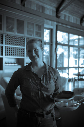 Happy waitress at winery