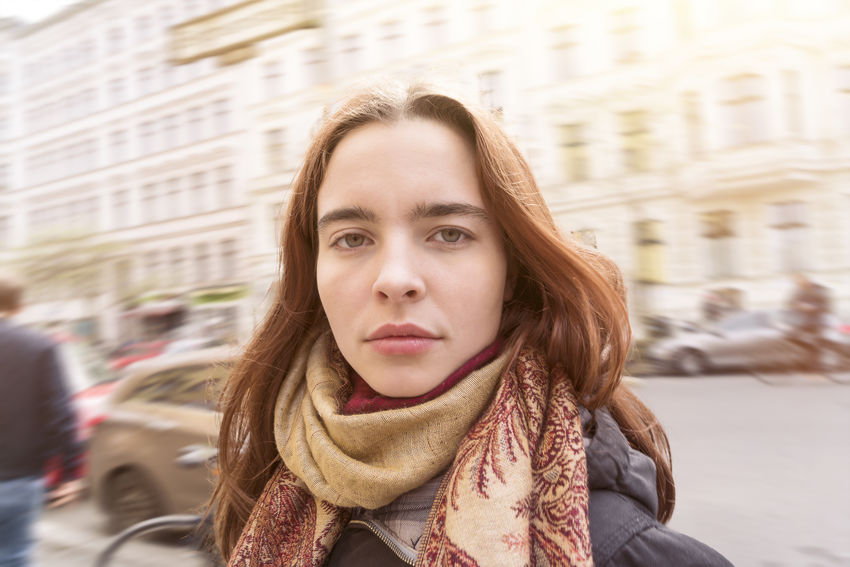 Architecture Beautiful Woman Close-up Female Fun Girl Lifestyles Looking At Camera One Person Outdoors Portrait Real People Scarf Selfie Smile Smirk Standing Street Teen Teenager Traffic Warm Clothing Woman Young Adult Young Women