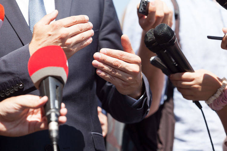 A businessman or a politician gesturing while talking to the media at press conference Midsection Microphone Input Device Hand Human Hand Group Of People Journalist Holding The Media Journalism Politician Interview Gesturing Talking Public Relations Publicity Publicimage Publicity Image Image Audio Recording Record Reporter Reporting Report Broadcasting Broadcasting Journalism Mic Explaining  Statement Q&A Question Answer Answering Information News Media Media Equipment Spokesman Spokesperson Businessman Speech Interview Interview Record Selfpromotion Elections Public News Conference Press Press Conference