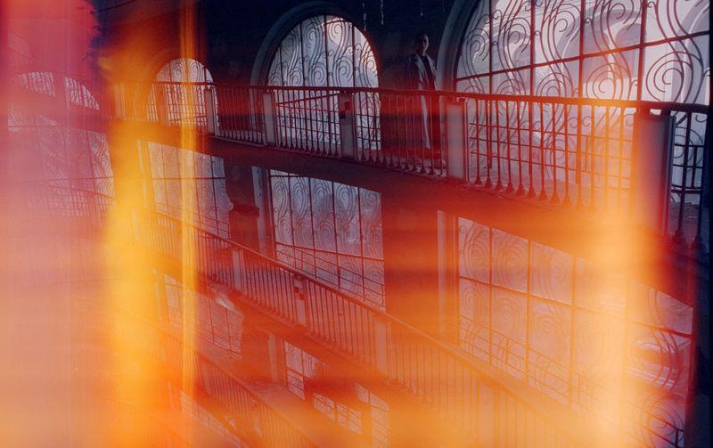 Digital composite image of metal grate window