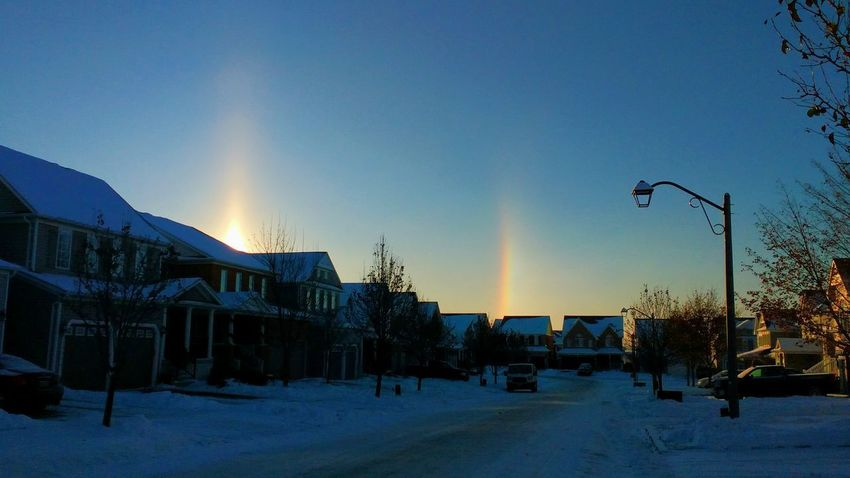 Sun Dog EyeEm Nature Lover Sun Dog Beauty In Nature Dramatic Sky Natural Phenomenon Street Morning Morning Light Blue Sky EyeEmNewHere Winter Snow Cold Temperature Outdoors Sky No People Clear Sky Sunlight