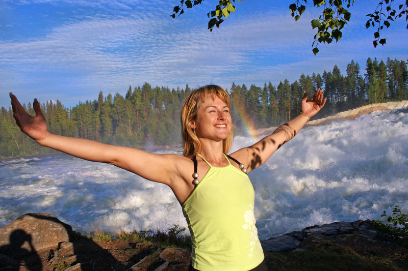 Arms Outstretched Arms Raised Beauty In Nature Cheerful Cloud - Sky Day Fun Happiness Leisure Activity Lifestyles Mountain Nature One Person Outdoors Photographing Photography Themes Real People Scenics Selfie Sky Smiling Standing Tree Young Adult Young Women