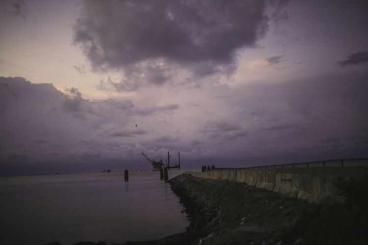 Fort Morgan Mobile Bay Alabama Cloud - Sky Sky Water Sea Beauty In Nature Scenics - Nature Tranquility Nature Beach Land Tranquil Scene Sunset Dusk Outdoors No People Idyllic Non-urban Scene Horizon Over Water The Great Outdoors - 2018 EyeEm Awards