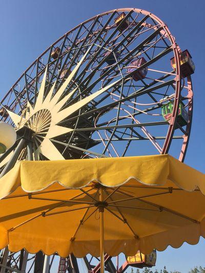 Ferris wheel at Disneyland Disneyland Amusement Park Amusement Park Ride Ferris Wheel Sky Low Angle View Arts Culture And Entertainment No People Clear Sky Fun