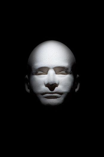 Close-up of human face against black background