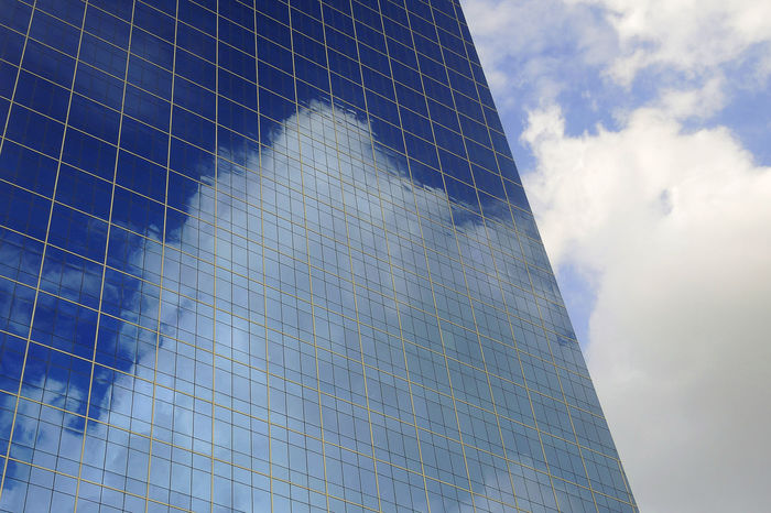 Blue sky and clouds reflected in windows of modern office building. Architecture Building Building Exterior Built Structure City Cloud - Sky Day Glass - Material Modern Office Office Building Exterior Outdoors Reflection Sky Skyscraper Tall - High Tower