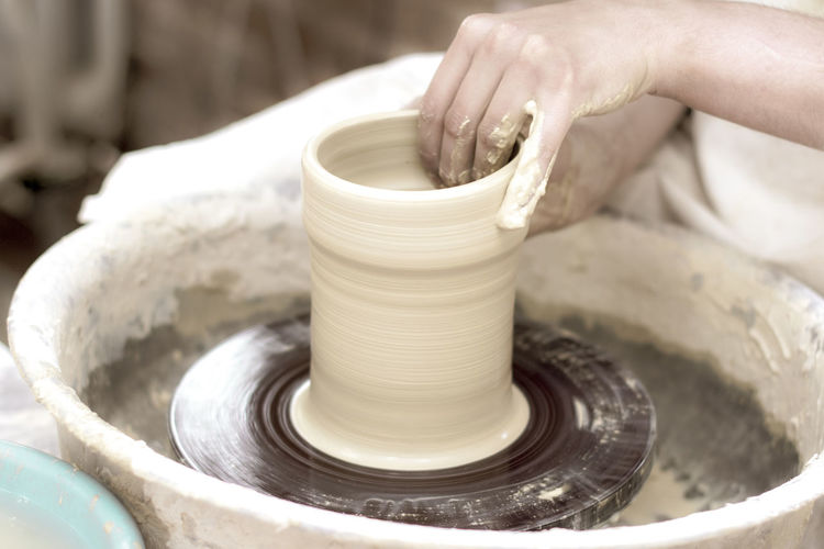 Hand Human Hand Pottery Spinning Craft Art And Craft Clay Human Body Part Molding A Shape Skill  Motion Creativity Unrecognizable Person Working Making One Person Expertise Craftsperson Occupation Real People Body Part Mud Preparation  Finger