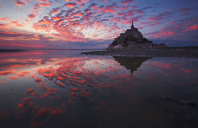 Landscape from the west coast of france at atlantic ocean. sunset with mont saint michel.